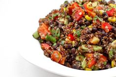 i eat this for lunch... at least twice a week. so good. quinoa, black beans, corn, pepper, avocado, tomato, lime juice, garlic, etc.