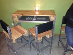 Simple desk & chairs made of pallet wood and angle iron.