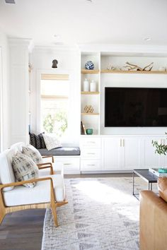 White built ins in the living room, white cabinets, brass fixtures. Built in shelves. studio mcgee living rooms and decor