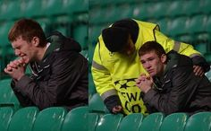 A steward consoles a Celtic fan after Champions League loss to Juventus
