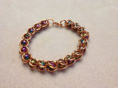 This #bracelet is made with #copper rings and multi-coloured #magnetic beads. These materials have been known to help provide some people with #pain relief.  http://jewelrybyjocelynleigh.ca/?product=coloured-magnets-copper-bracelet