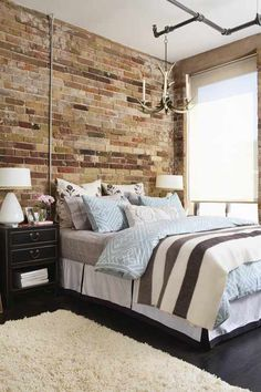 Brick envy. I have always wanted an indoor brick wall, concrete floors, and exposed ceilings...