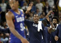 United States' Kevin Durant, center, celebrates with teammates following their win over China in a men's basketball game at the 2016 Summer Olympics in Rio de Janeiro, Brazil, Saturday, Aug. 6, 2016. (AP Photo/Eric Gay)