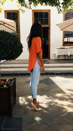 loose short sleeved blouse. paired with skinny jeans or slim ankle pants. orange and light denim.