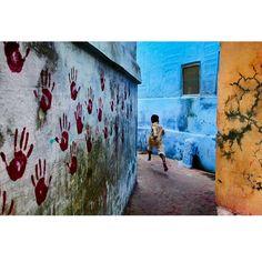 A young boy dashes through the narrow alleyways of Jodhpur, Rajasthan.  #Jodhpur #Rajasthan #India #photooftheday @magnumphotos