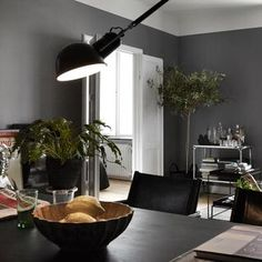 Dramatic dark greys in a Swedish apartment (spot the legs!)