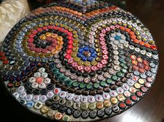 Beer bottle cap table. I tried to incorporate my husband's favorite breweries :)