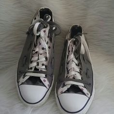 Grey and poka dot converse sneakers. They have a double layer top. The shoe strings are grey and white, but extra long. However you may purchase shorter ones. In great condition but has slight signs of wear. Please feel free to ask questions. Also please no trades' holds or pp. Converse Shoes Sneakers