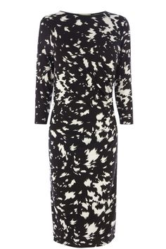 The tube dress is our pick of the season, make a statement in this bold printed number. The piece features a monochrome blurred print across the fabric and has a high, round neckline. The dress is finished with 3/4 sleeve styling.#autumncovered