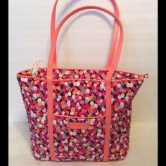 """Vera Bradley Trimmed Vera Tote Bag iPixie Confetti Very Bradley Small trimmed tote in Pixie confetti,... Signature cotton with solid faux leather trim. Recessed zip-top closure. Size large inside slip pockets, one slip & one outside zipper pocket. 11 1/2"""" x 11 1/4"""" x 4 1/2"""" with 12"""" strap drop. NWT Vera Bradley Bags Totes"""
