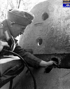The Russian T-34/76D Model tank in 1943 was fitted with a larger cast armor turret, which allowed space for three crewmen. However, this turret has received three hits from 75 or 88mm armor piercing (AP) rounds all of which penetrated.
