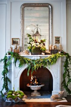 Love everything about this but esp. The shell filled with moss and amaryllis bulbs and the fire in the bowl.