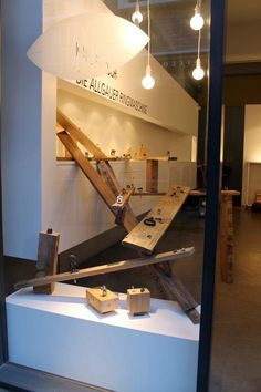 Great display: mostly rings shown on raw wood cube and boards, with bent nails to keep them in place. Gallery Funaki