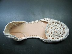DIY crochet sandals.  The pattern costs $$ and I'm a cheapo so I think I can figure this out.. trace the bottom with one of my flip-flops, rounded granny squares for the tops, slip stitch around the edge and work up heel and toe in single crochets until it fits?  Hmm..