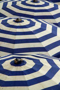 blue and white striped beach umbrellas