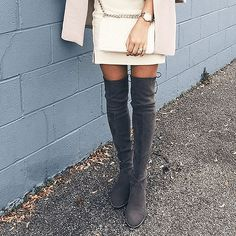 We're loving this pretty Fall outfit from @Vitamusiyech She pairs a blush coat with all the right statement pieces: Stuart Weitzman over-the-knee boots and a Winter-white, quilted crossbody bag.