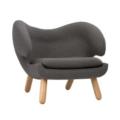 """From the pelican-shaped """"wings"""" to its solid walnut legs, this lounge chair should be a staple in every modern home. Inspired by an iconic Danish mid-century design, the chair's roomy, high-density foam seat and oversized back means repartee with guests can last into the wee hours of the night. Make it your conversation pit's statement piece and watch guests sink into the comfort of the chair's form."""