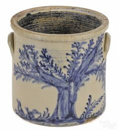 """New York stoneware crock, 19th c., impressed {Haxton, Ottoman & Co., Fort Edward NY}, having a large branching tree with two ducks on the ground under an overhanging limb, 12"""" h. Illustrated in Webster, Decorated Stoneware of North America, fig. 181, page 144. Provenance: Formerly in the Weeks Collection. Estimate: $12,000-16,000"""
