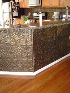 Tin ceiling panels --We did a backsplash in my parents house with copper ones--very cool. Steampunk Kitchen, Steampunk House, Steampunk Bar, Steampunk Home Decor, Metal Ceiling Tiles, Ceiling Panels, Steampunk Bedroom, Timeless Kitchen, Tin Tiles