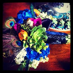 Wedding bouquet peacock theme, love it but i would take the orange and white out of it.