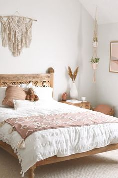 boho bedroom wall colors Use a large macrame wall hanging as an over-the-bed statement piece of art. The pink and white color palette in this boho bedroom pair beautifully with the light wood colors. Photo by blakealexiss Bedroom Wall Colors, Boho Bedroom Decor, Boho Room, Room Ideas Bedroom, Wood Bedroom, White Bedroom Walls, Bedroom Inspo, Bohemian Bedding, Photos In Bedroom