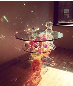 The Sparkle Palace Cocktail Table Reflects Rainbows Around the Room #livingroom #homedecor trendhunter.com