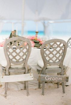 Driftwood bride and groom signs are the perfect way to decorate your reception chair backs at your sandy party | Brides.com