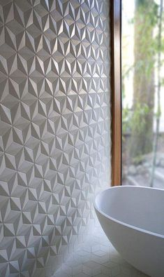 Geometric shapes create a stunning statement wall in this bathroom.