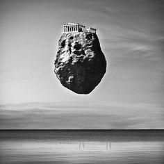 World Landmarks Levitate on Boulders Over the Ocean - My Modern Metropolis
