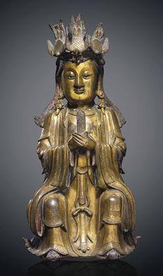 A GILT-BRONZE FIGURE OF A DAOIST DEITY 16TH/17TH CENTURY - Ming dynasty (1368-1644)