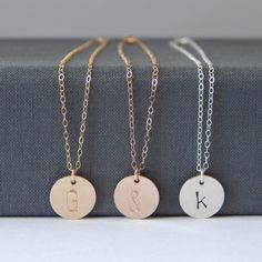 "One (1) personalized, hand-stamped, 1/2"" disc in your choice of Sterling Silver, 14k Gold Fill, or 14k Rose Gold Fill on a matching chain. Gorgeous, minimalist and perfect for layering! ✚ Disc measures 1/2"" ✚ Arial letter/number measures 6mm✚ All necklace components are Sterling Silver or 14k Gold Filled (including jump rings) ✚ All jewelry is completely lead + nickel free✚ All orders include one (1) complimentary polishing cloth to help you keep your items looking shiny and new! If you need…"