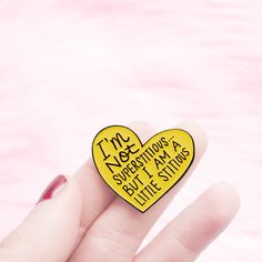 """Enamel lapel pin featuring Michael Scott's quote from The Office, """"I'm not superstitious but I am a little stitious."""" Wear your love for Michael Scott or Steve Carell on your sleeve with this The Office lapel pin by Kate Gabrielle. Michael Scott Quotes, Office Quotes, Steve Carell, Lapel Pins, Love Heart, Coupon Codes, Funny Quotes, Patches, Enamel"""