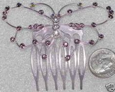 ADORABLE AMETHYST COLOR AND ROSE CRYSTAL WITH AB CRYSTAL BUTTERFLY COMB....THIS IS A SMALLER VERSION OF THE BIGGER BUTTERFLY COMB....LIKE THOSE THIS ONE CAME IN 12 DIFFERENT COLOR COMBINATIONS...ALL STUNNING....BUT ONLY 1 PIECE IN EACH COMBINATION....WHEN INSERTED INTO THE HAIR THE COMB COMPLETELY DISAPPEARS AND ALL YOUR LEFT WITH IS THE BUTTERFLY!....SO ADORABLE............