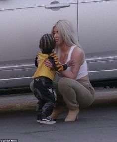 Hugs for mommy: It's clear Kim dotes on her children