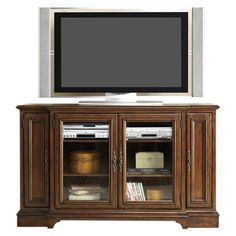 Media console with brass hardware and 2 glass-front doors opening to adjustable shelving. Features French and English dovetail construction and a cognac fini...Keeley Media Console- Joss & Main