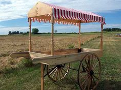 buggy.com vending cart: For an SCA or RenFaire period design, should use different wheels (solid planks). This is also rather pricey...