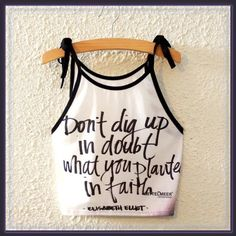 "Inspirational quote tank crop top ➖NWT ➖SIZE: small-medium ( see measurements ) ➖STYLE: a tank crop top that quotes ""Do not dig up what you have planted in faith"" by Elisabeth Elliot   ➖MEASUREMENTS     ➖BUST: 18""    ➖LENGTH: 14.5"" Tops Crop Tops"
