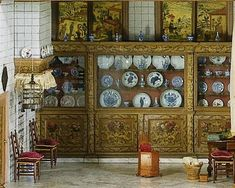 Kitchen in the dolls house of Petronella Oortman, showing the painted silk screens set into the windows above the dresser. Image in the public domain, supplied by the Rijks Museum.