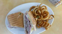 Cuban sandwich with spiral wedge fries
