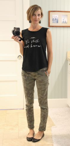 be still clothing company shirt and camouflage pants