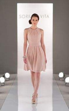 Elegant A-line peach bridesmaid dresses in Chiffon feature an illusion neckline and ruched waistband. Exclusive designer bridesmaid dresses by Sorella Vita.