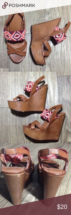 Chinese Laundry tan platform wedges Sz 6.5/37.5 Chinese Laundry tan platform wedges with purple/orange/white tribal print in upper strap. Size 6.5/37.5 in great condition with a few scuffs on sole area, platform, and heel. If you have any questions or need extra pictures please leave a comment below. Chinese Laundry Shoes Platforms