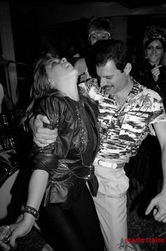 QUEEN — Freddie Mercury with Samantha Fox during a party...
