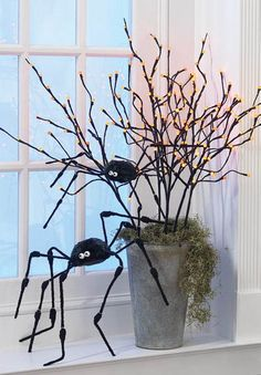 NEW for Halloween 2012 the RAZ Imports Ghastly Graveyard Collection Filled with witches, spiders, jack o lanterns, skeletons and . Halloween Trees, Holidays Halloween, Halloween Crafts, Scary Decorations, Halloween Decorations, Halloween Lighting, Halloween Centerpieces, Branch Centerpieces, Lighted Branches