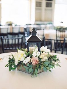 The dusty rose color makes a nice subtle color pop in this beautiful centerpiece idea