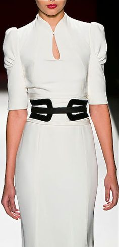Carolina Herrera I know we're partial to white and black, cant help it, always looks so elegant and matches our company colors !
