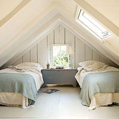 Used in this small attic space, white creates a sense of airy feel against the sloped ceiling