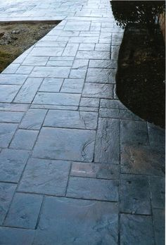 Trying to figure out what color to stain our stamped concrete porch floor...LOVE THIS SLATE LOOK!