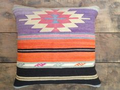 """We love the light and airy purple in these cushions, which is set off by the vivid black. Great colors, black back, center zipper with a removable feather-down insert. 2 available. 22"""" square. Handmade in LA."""