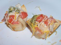 Great idea using wonton paper for the chip part. Place wonton paper in mini cupcake pan, spray with veggie oil and bake for 10 mins at 350. Then fill with whatever toppings you want!! I used steak, chicken, avocados, tomatoes, onion, cheese, sour cream, & salsa....So good!! Idea came from rachel ray's tv show!! Props to her! Could also use chicken salad, crab salad, or cheese ball inside of it!